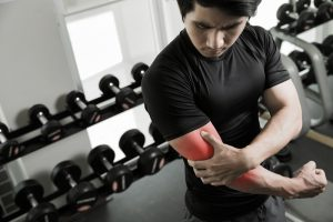 man holding injured painful elbow