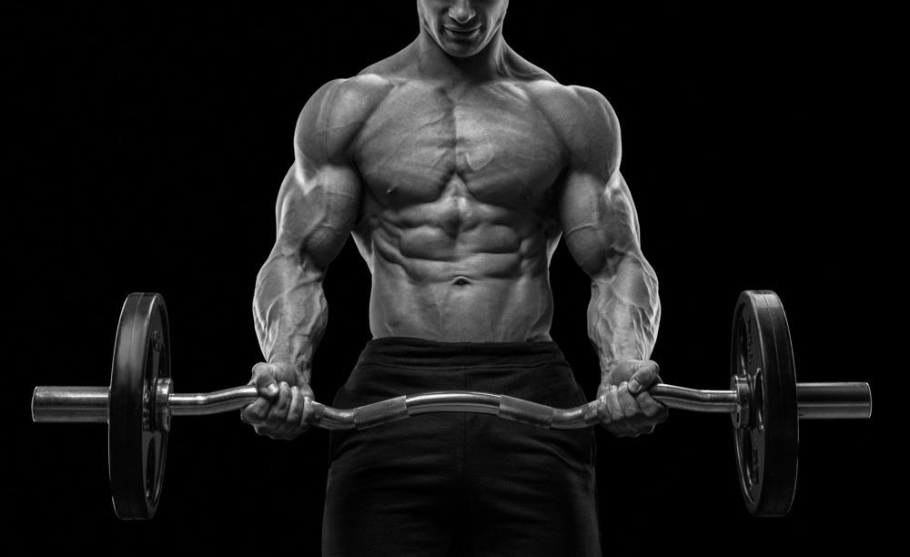 muscular man lifting heavy barbell higher stamina
