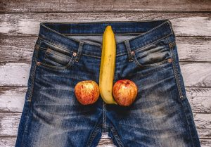 banana and apple out of mens jeans like penis and balls