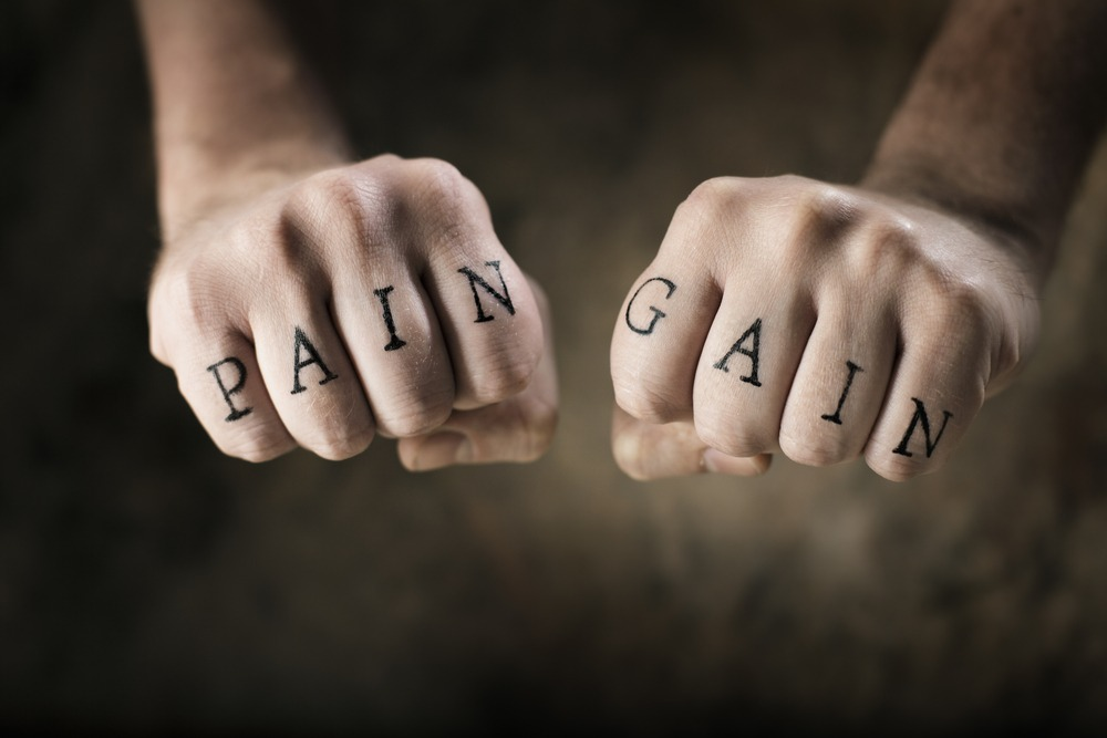 pain gain written on both hands