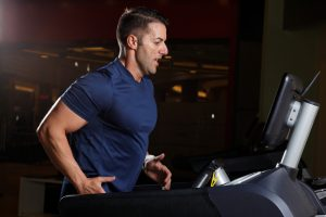 man intense run on treadmill