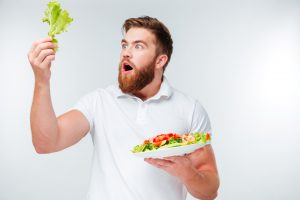 vegan guy in awe of lettuce