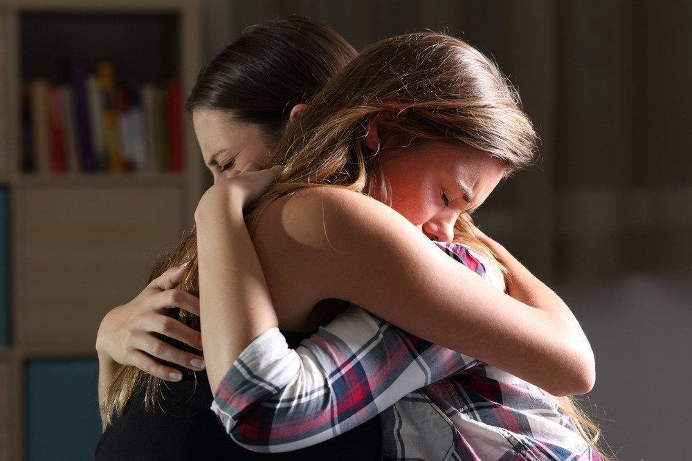 family hugging each other after terrible news of dying