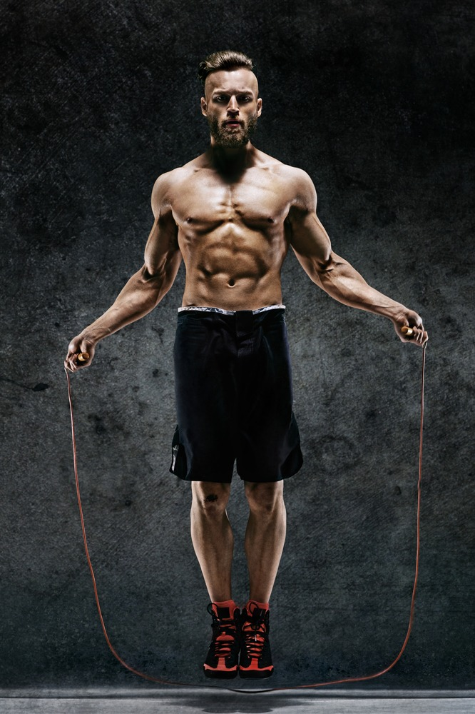 ripped guy jumping rope