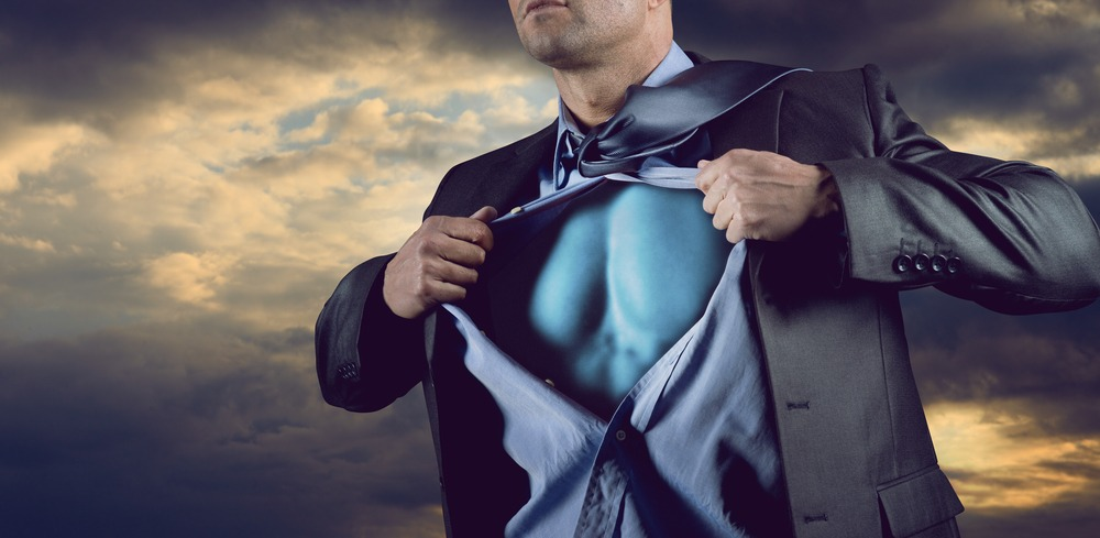 man in suit revealing superhero body underneath shirt