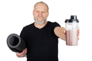 elder man with protein shake