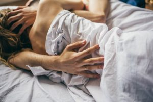 couple getting busy in bed